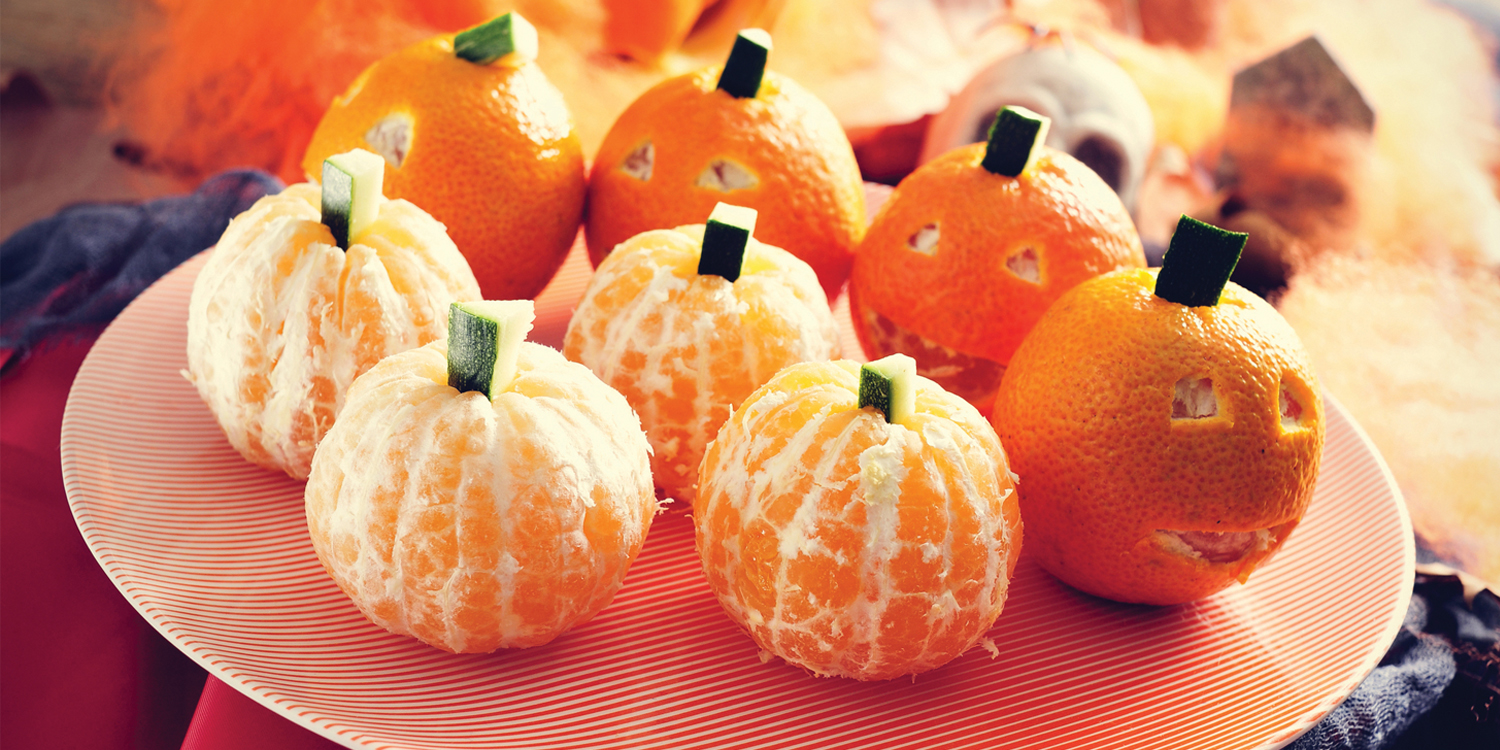 oranges made to look like pumpkins
