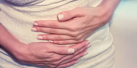 A woman rubbing her uncomfortable stomach