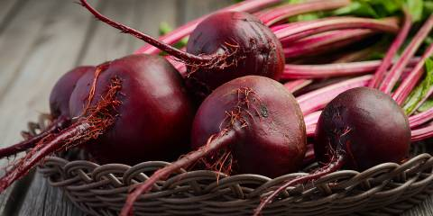 Fresh beets on a wooden table.