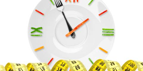 A clock made out of food and a measuring tape
