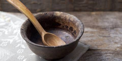 An empty bowl with a wooden spoon