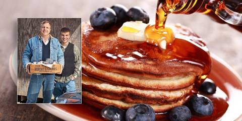 Proud syrup farmers and a nice pile of pancakes