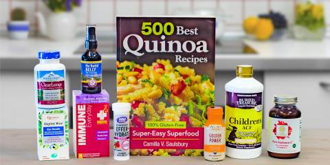 a selection of all-natural supplements and a book of gluten-free quinoa recipes