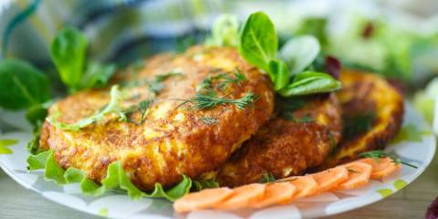 salmon fritters on a bed of lettuce