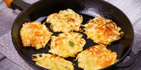 Sweet potato Latkes in frying pan.
