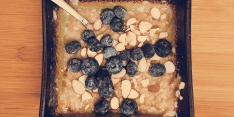 A bowl of porridge with blueberries