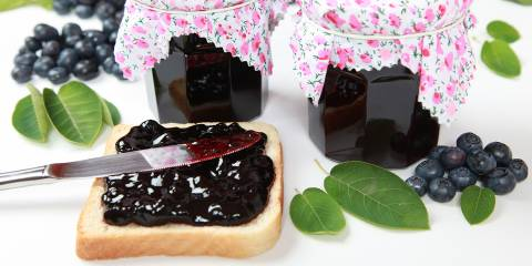 Homemade blueberry jam spread on toast