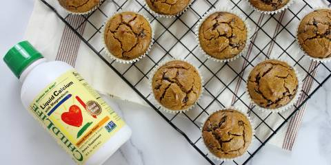fresh-baked gluten-free muffins and a bottle of liquid calcium