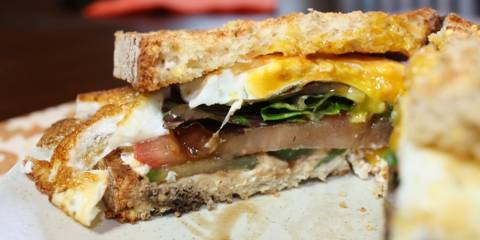 Mediterranean Breakfast Sandwich cut in half and ready to eat.