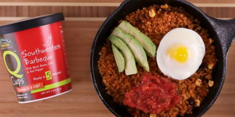 A pan of quinoa, egg, avocado, and salsa