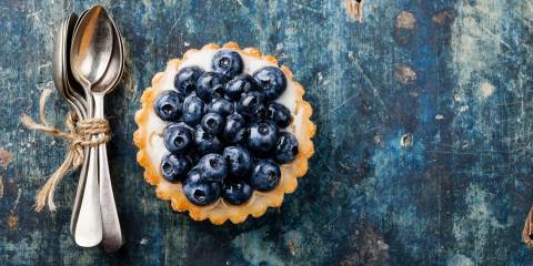 Blueberry tart and spoons