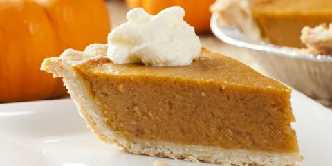 A slice of pumpkin pie with gluten-free crust