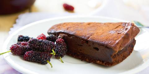 Chocolate truffle torte by berries and tea.