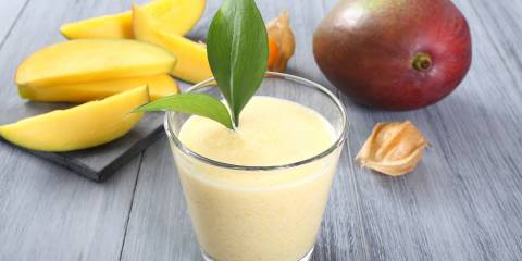 a glass of fresh mango smoothie