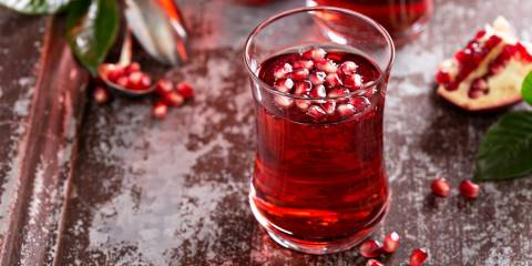 An icy glass of pomegranate-apricot sparkler