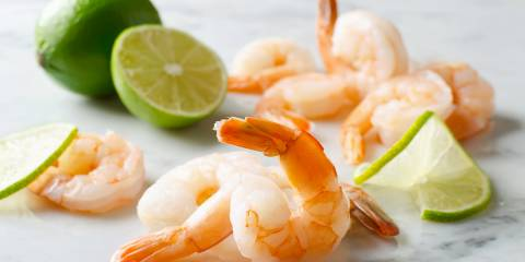 shrimp and sliced limes
