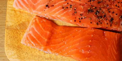 Salmon prepared for grilling.