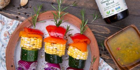 grilled veggies skewered on rosemary springs