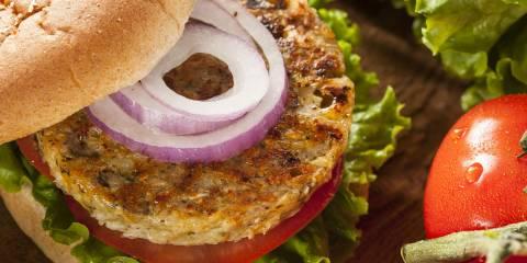 Veggie burger with onion, tomato and lettuce on wheat bun