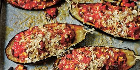 Stuffed eggplant on a baking sheet.