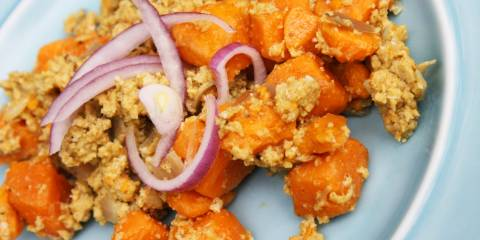 A plate of sweet potato scramble with red onion on top