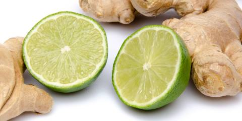 Ginger roots and sliced limes