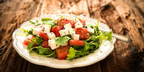 A mmix of watermelon, arugula, and feta cheese