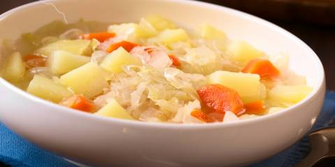 A bowl of vegetarian irish stew with cabbage and potatoes