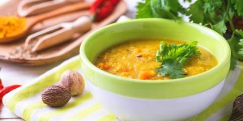 A steaming bowl of red lentil Dal Masoor