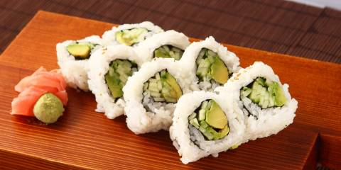 vegan maki rolls on a board with ginger and wasabi