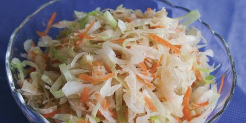 A bowl of cabbage, carrots, and sauerkraut