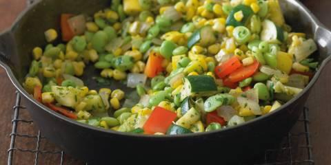 a skillet of sautéed corn and diced vegetables