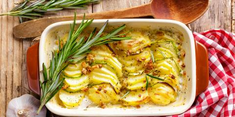 A dish of potatoes au gratin with rosemary
