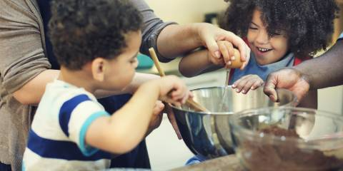 Kids helping to make cookies.