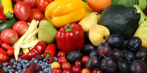 Fresh fruits and veggies in a colorful pile.