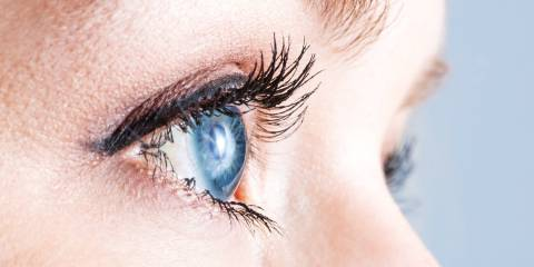 A close-up of a woman's clear blue eye