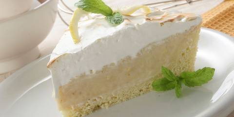 A slice of creamy lemon pie with gluten-free crust