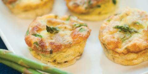 A plate of home-made mini-frittatas with asparagus, spinach, and chicken sausage