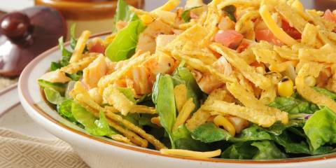 a plate of seasoned filling and tortilla strips