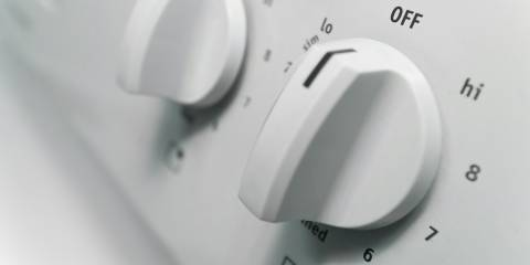 temperature knobs on a home stove-top range