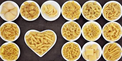 bowls of uncooked pasta in many shapes and designs