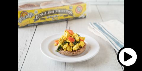 an english muffin topped with tofu scramble