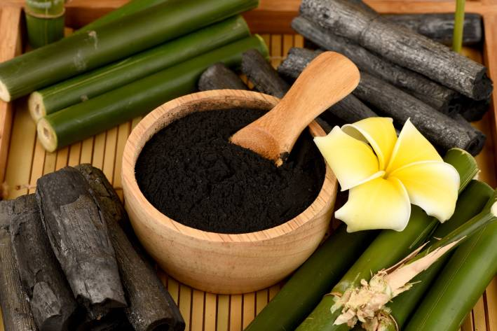 Activated Charcoal in a wooden bowl.