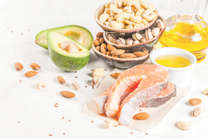 Foods full of healthy fats, like nuts, avocado, and salmon