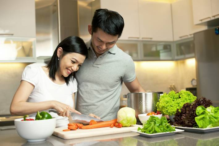 A couple preparing dinner together.