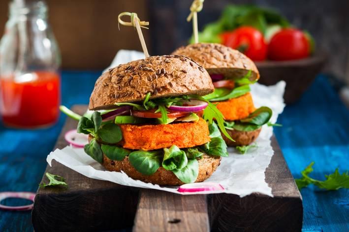 A veggie burger with avocado