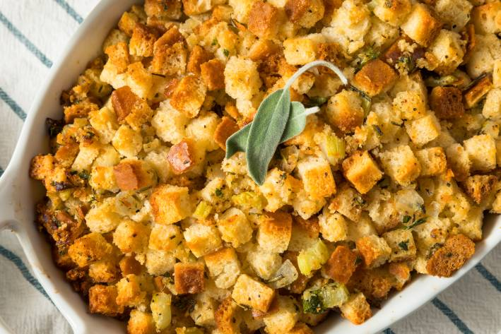 Gluten-Free Pear and Pecan Stuffing in a white baking dish.