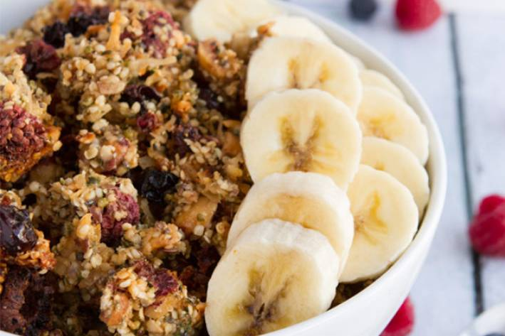 a bowl of granola made from nuts, seeds, and berries