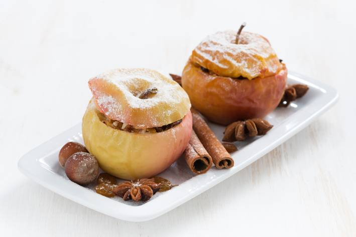 Baked apples on a white plate