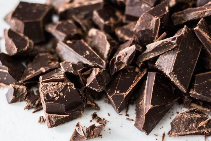Chunks of chopped semi-sweet chocolate, ready to melt